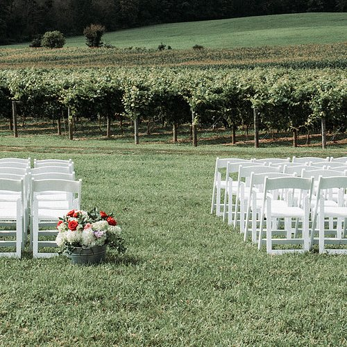 Image of Ceremony with White Padded chairs