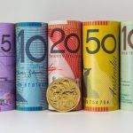 Australian dollar slides to session lows near mid-0.6700s