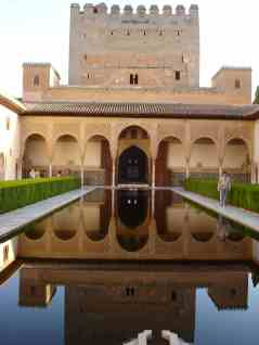 """The Comares Palace comprises a group of rooms joined around the """"Arrayanes"""" courtyard, with porticoed galleries on both ends."""