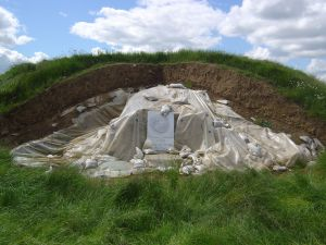 The Mound of Hostages during reconstruction. The exposed orthostats and lintels have been protected from the elements with plastic sheeting.