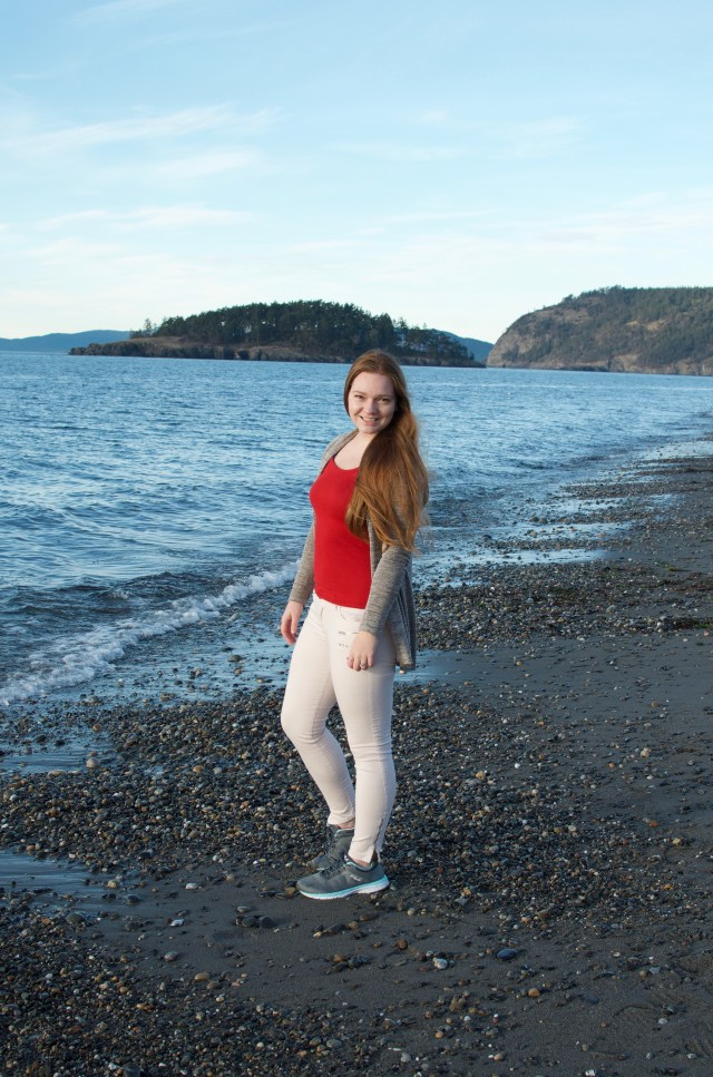 Woman smiling, with ocean in the background