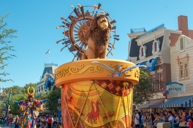 Simba from Lion King roaring atop a float in a Disney parade