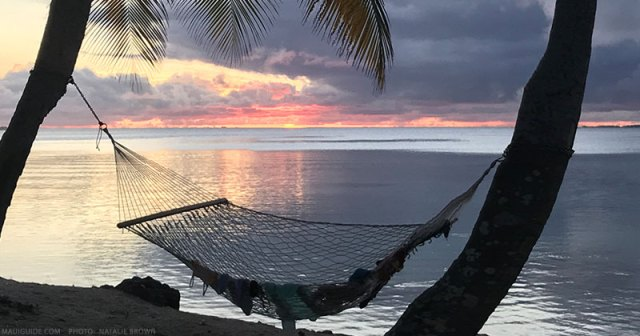 Photography of hammock with sunset in the background