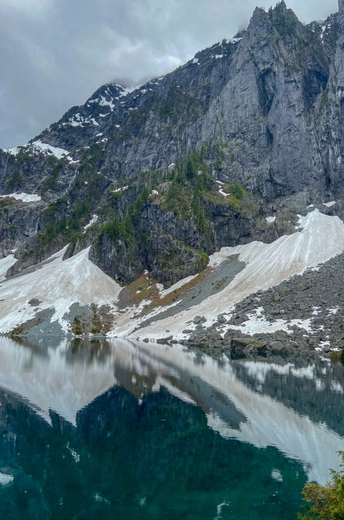 Looking at Lake Serene, a deep blue alpine lake surrounded by sharp mountain peaks