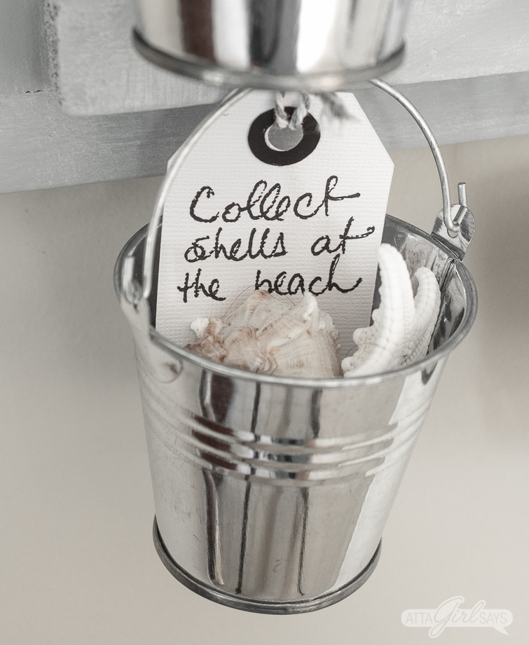 closeup of a miniature bucket filled with shells