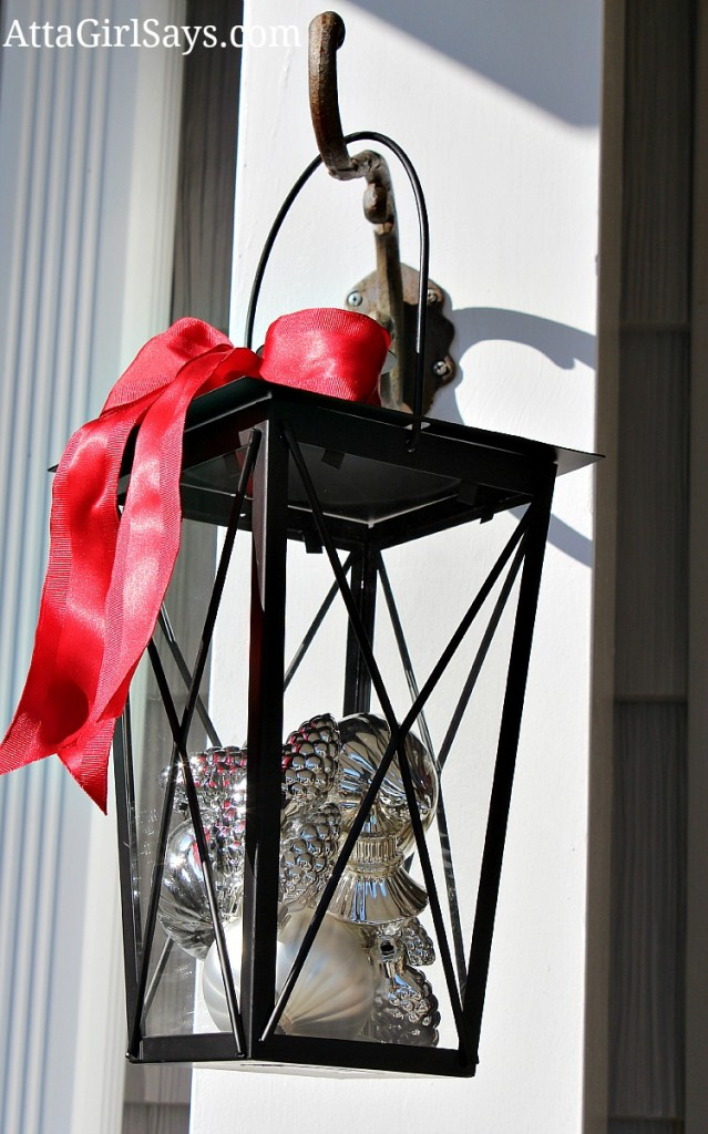 lantern filled with Christmas ornaments