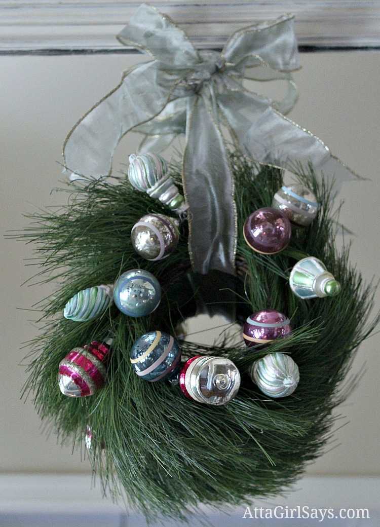 vintage ornament Christmas wreath in pink and green and blue