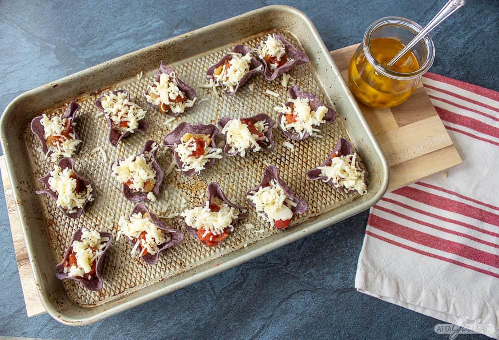 blue corn tortilla chip appetizers on a sheet pan