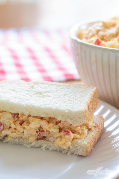 pimento cheese sandwich of a white paper plate