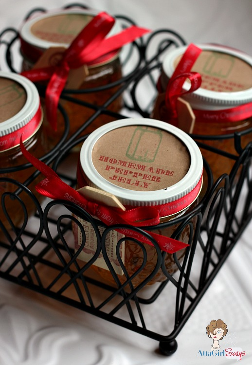 jars of homemade pepper jelly with kraft labels in a wire caddy
