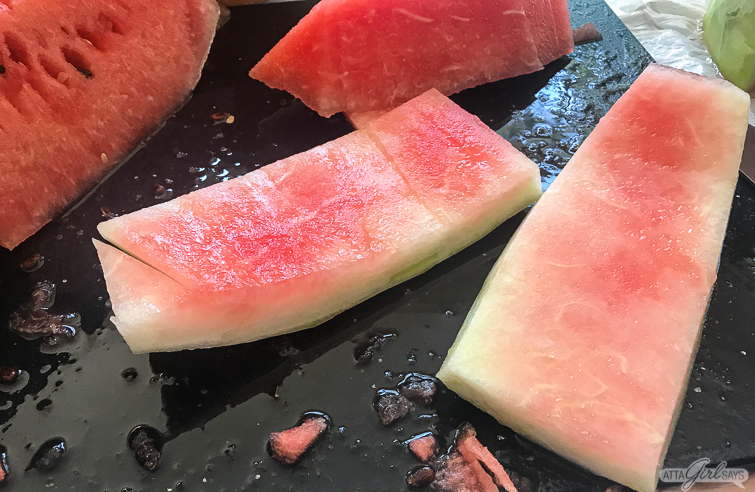 cutting the rind to make watermelon rind pickles