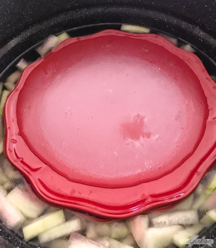 use a plate to weight down the rind when making watermelon rind pickles