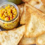 homemade flour tortilla chips with a jar of corn salsa