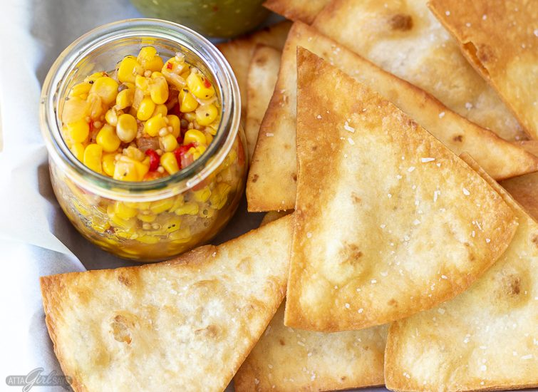 homemade flour tortilla chips with a jar of corn salsa