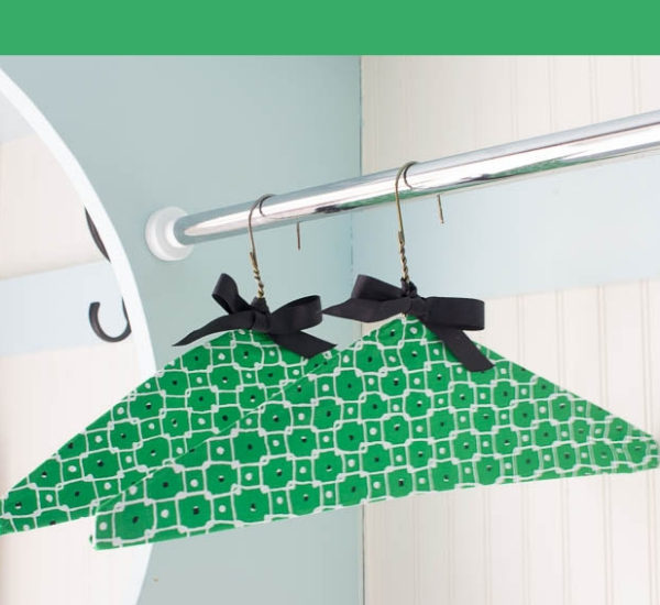 green fabric clothes hangers