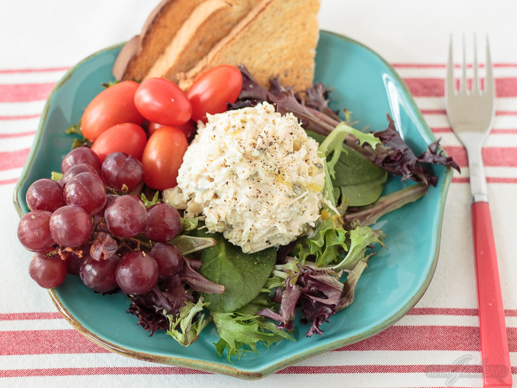 grapes, tomatoes and a scoop of traditional homemade chicken salad on a bed of lettuce