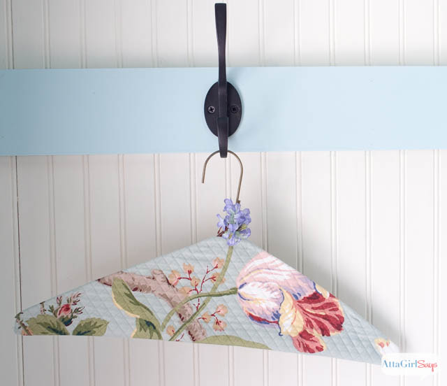 quilted fabric clothes hanger on a hook