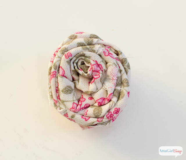 How to Make a Rolled Fabric Flower - Click for a full tutorial at AttaGirlSays.com