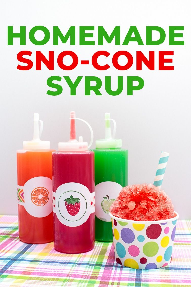 three bottles of homemade snow cone syrup with a sno-cone