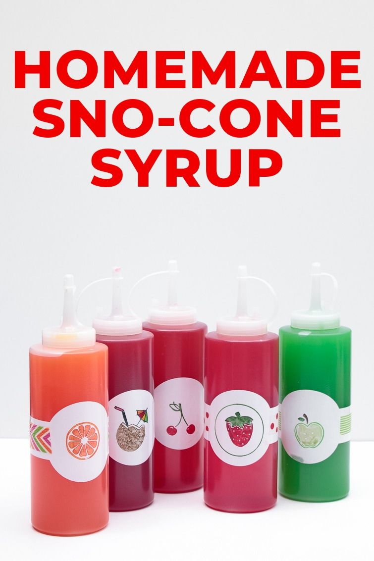 five bottles of homemade snow cone syrup with fruit labels