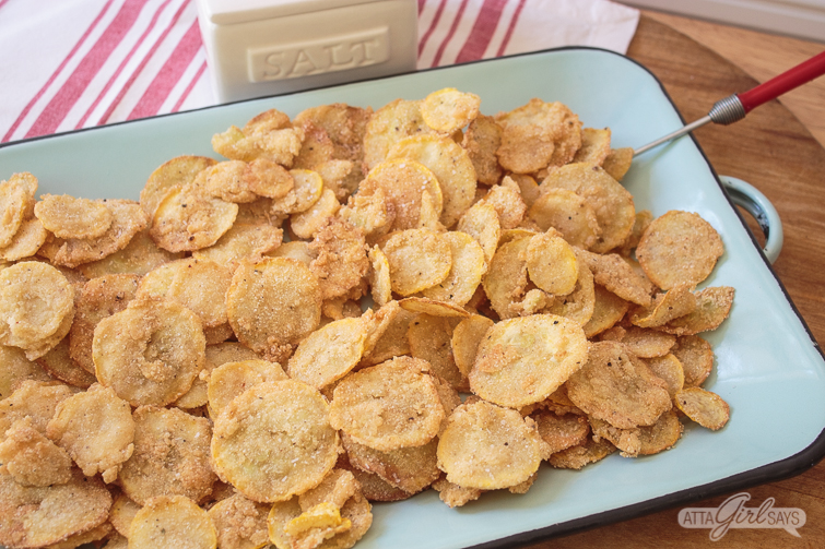 thin and crispy fried squash on a blue enamelware platter