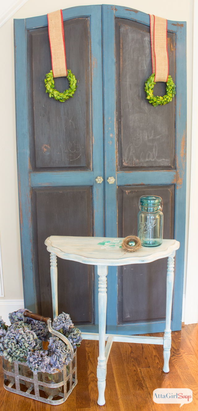 Inspired by the beautiful beach glass, this Sea Glass Table is painted with a base coat of blue chalk paint, topped with a white wash and antiquing.