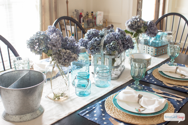 Who says fall decorating has to include pumpkins and the color orange? This dining table setting celebrates fall with the use of beautiful blue dried hydrangeas
