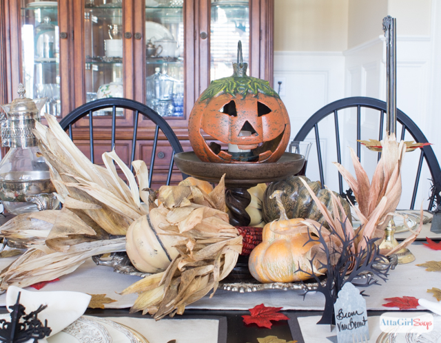 A Legend of Sleepy Hollow Halloween: Washington Irving's chilling short story of Ichabod Crane and the headless horsesman inspired this Halloween tablesetting.  The details are amazing; I especially love the Sleepy Hollow sign, the tombstone place cards and the spooky paper trees on the table. And that jack-o-lantern is pretty scary, too!