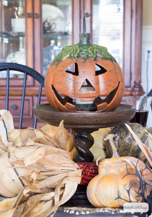 cast iron jack o lantern used as a table centerpiece for Halloween