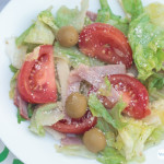 1905 salad with olive, ham, tomatoes and swiss cheese