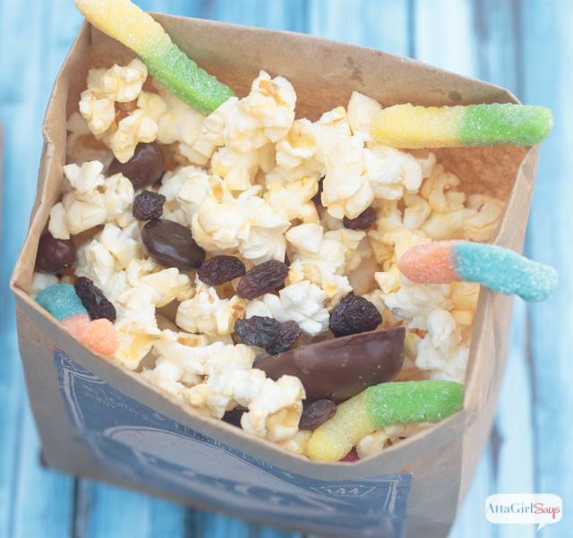 "Host a The Boxtrolls family movie night. Make this ""buggy"" popcorn snack mix using Pop Secret and your favorite candy and pretend you're one of The Boxtrolls. Click for more family movie night ideas."