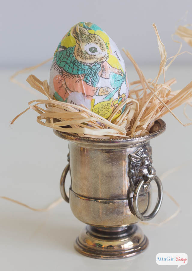 decoupaged Easter egg in a silver urn