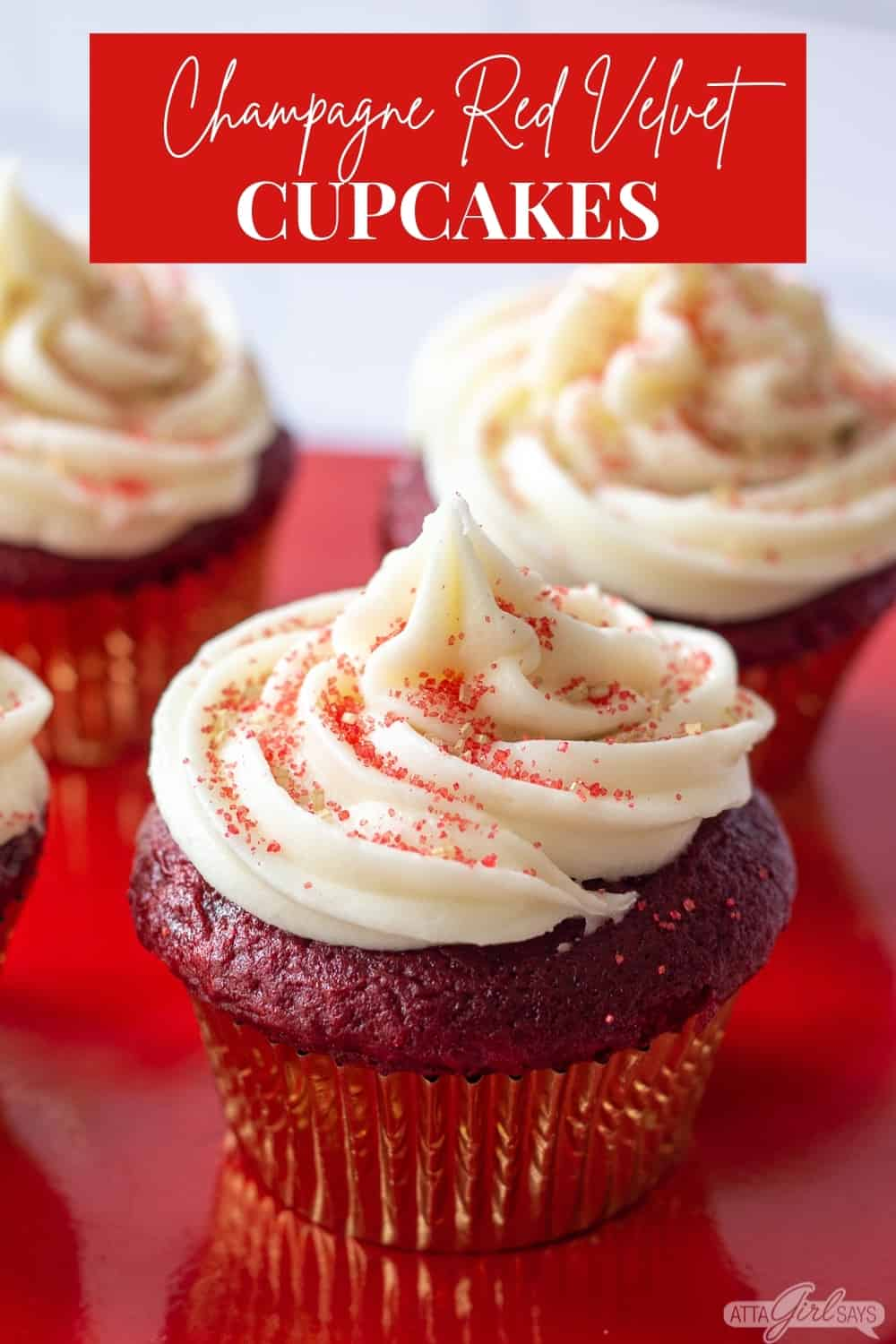 red velvet cupcake with gold and red sugar topping and cream cheese frosting
