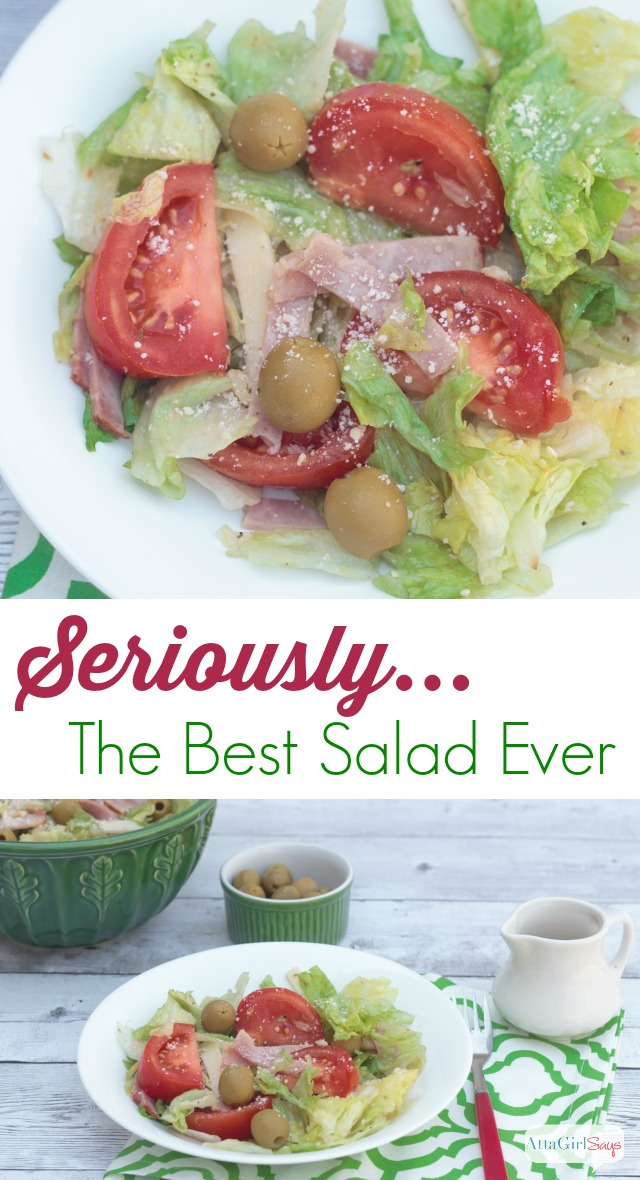 best salad recipe with iceberg lettuce topped with ham, swiss cheese, tomatoes and olives in a homemade garlic dressing