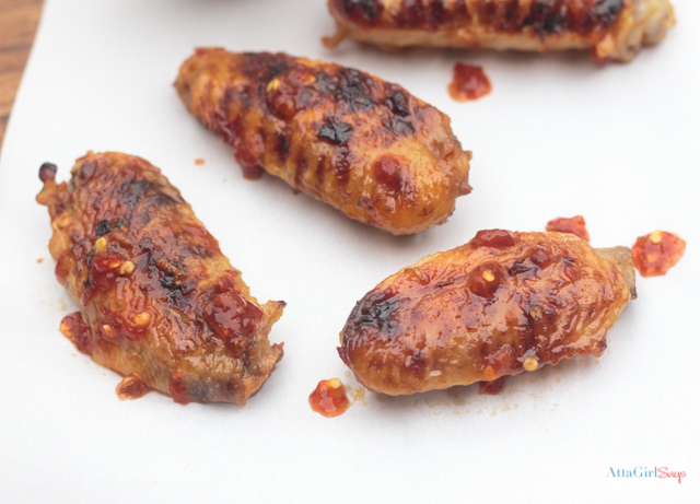asian grilled chicken wings on parchment paper