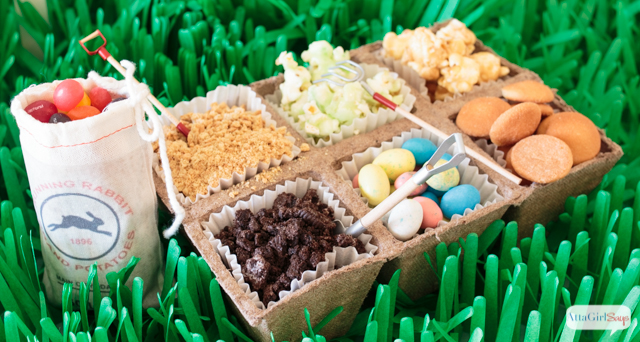 Easter candy and pudding toppers in peat cups at a Peter Rabbit Easter party