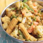 Navratan Korma Indian Food in a stainless bowl