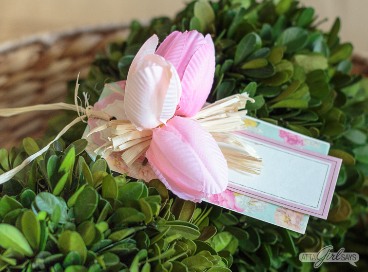 handmade spring gift tag with tulips sitting on top of a preserved boxwood ball