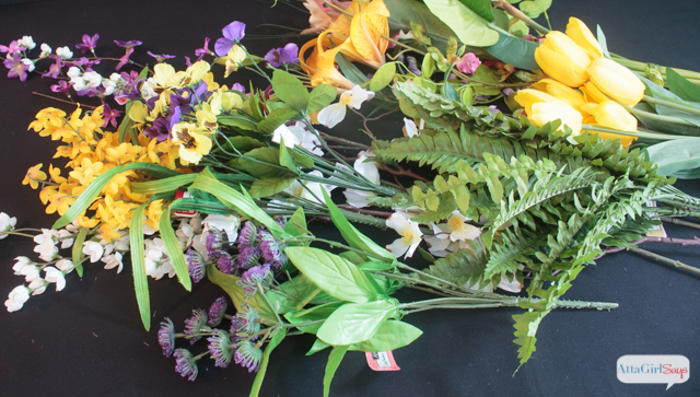 What a beautiful grapevine wreath. The purple, yellow and white flowers are perfect for spring!