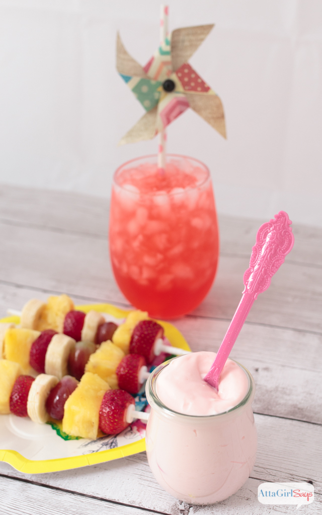 jar of yogurt fruit dip with fruit skewers