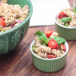pesto pasta salad in green bowls