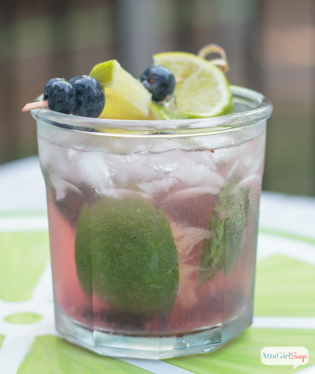 blueberry basil mojito garnished with fresh blueberries and lime
