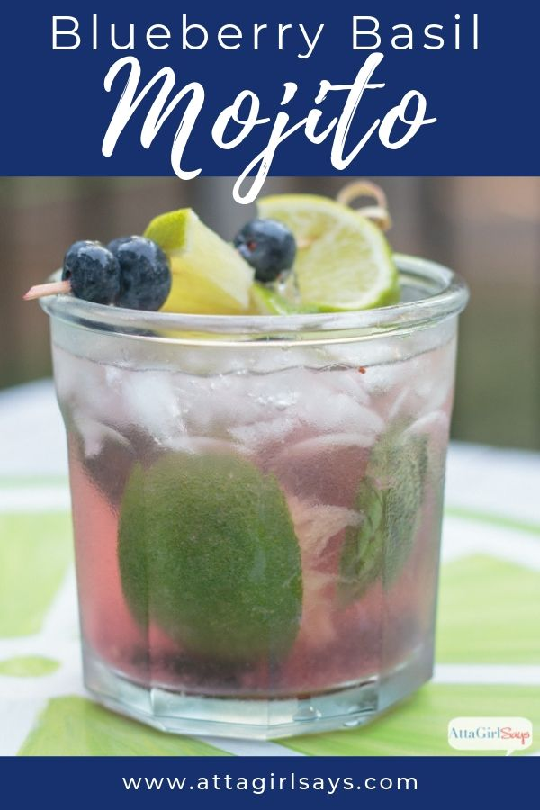 blueberry basil mojito garnished with blueberries and limes