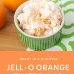 bowl of JELL-O orange salad on a green and white napkin