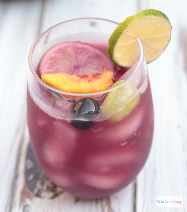 glass of red wine Sangria with fruit floating in it