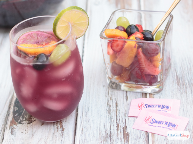 glass of red wine sangria with fruit and Sweet'n Low packets
