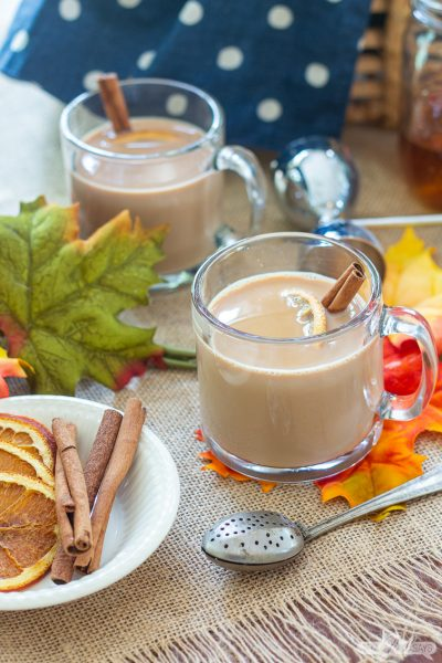 clear glass mug of chai tea latte with a text overlay