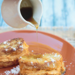 pouring syrup over pumpkin pie stuffed French toast