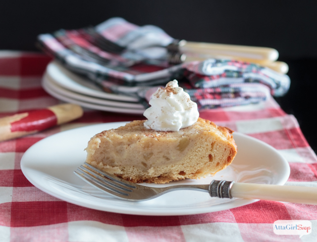 slice of homemade applesauce pie on a checkered tablecloth