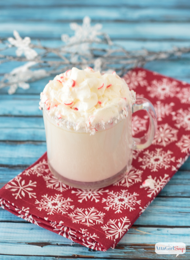 white chocolate peppermint mocha in a glass mug garnished with peppermint candy
